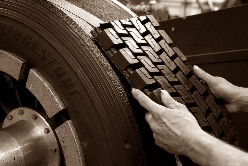 retread tires over new tires